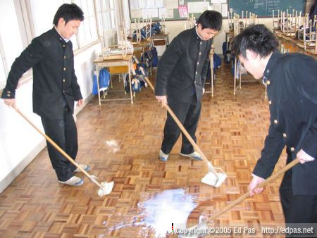 photo of boys attempting to wax their classroom floor