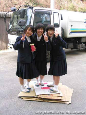 photo of girls standing on cardboard