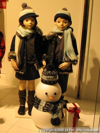 black-clad winter children, with matching snowman