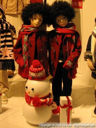 red-clad winter children, with matching snowman and afro wigs