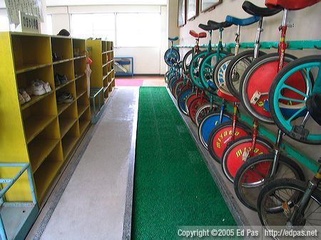 student entrance, with shoe shelves and unicycle racks