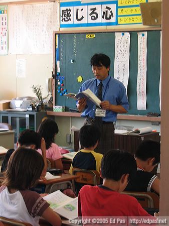 Arimoto-sensei reading to the class
