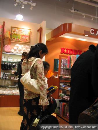 a mother browsing the shelves of Kiddyland in Riverwalk