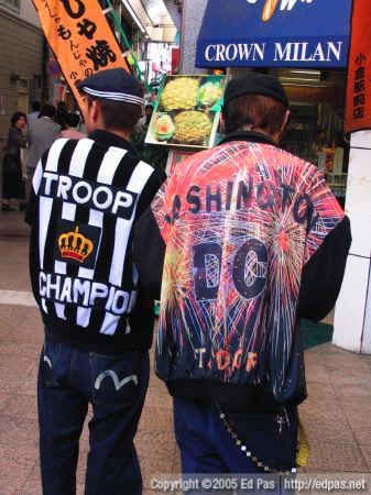 two young men in colourful sportwear strutting their stuff in front of Crown Milan bakery in the Kokura arcades