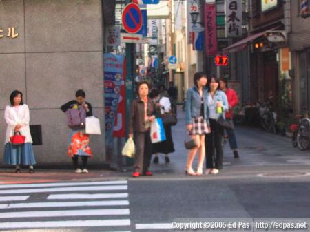 people waiting to cross a street in Kokura