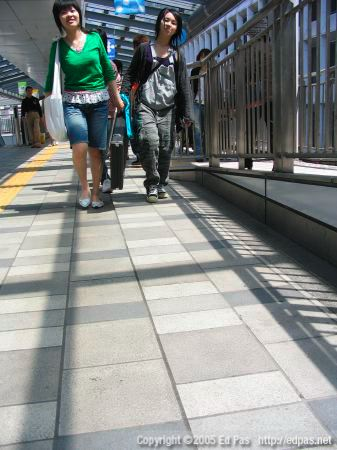 women on the elevated walkway to Laforet Harajuku, north of Kokura station