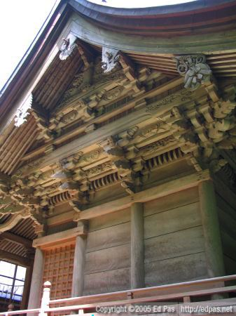 view of the elaborate woodwork under the eaves of the third shrine building