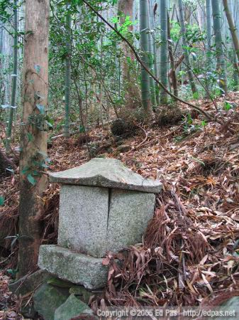 a small closed stone altar, with forest in the background