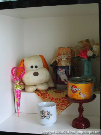 minimalist altar to a fluffy white dog