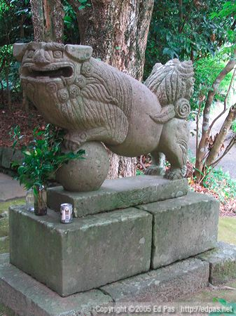 Sumerian-looking lion dog, with beer, at a shrine in Miyazaki City