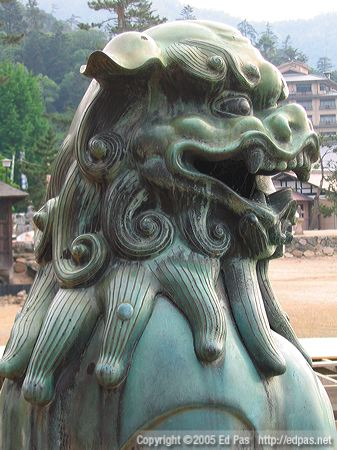 bronze lion dog at Itsukushima Shrine, looking out to sea