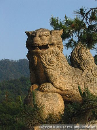 stone lion dog near the entrance to Itsukushima shrine