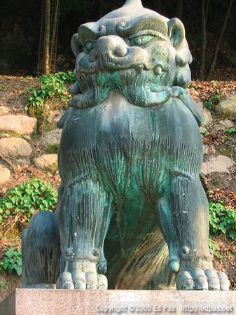 bronze lion dog on the path to Itsukushima shrine