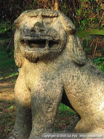 open-mouthed shishi at abandoned shrine near the coast along Wakamatsu north shore, Kitakyushu