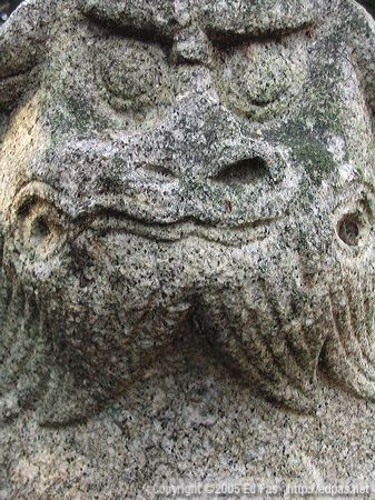 detail of closed-mouthed shishi at abandoned shrine near the coast along Wakamatsu north shore, Kitakyushu
