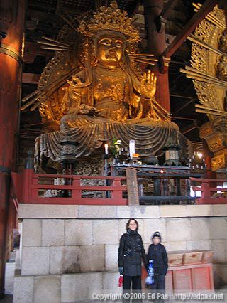 Lia and Jarrod standing in front of one of the Buddhas inside Todaiji Temple, Nara