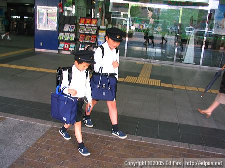 two schoolboys in front of Tobata Station