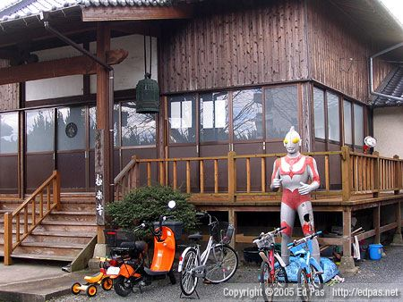 Ultraman makes a pit stop at a neighbourhood temple in Showa-machi